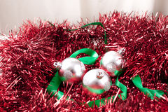Arrangement of Silver Christmas Ornaments and Ribbon on Garland Stock Photo
