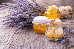 Arrangement of small glass jars with lavender Stock Photos