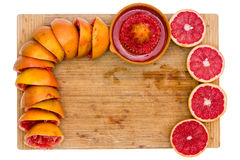 Arrangement of squeezed and fresh cut grapefruit Royalty Free Stock Images