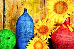 Arrangement of sunflowers and ceramic vases Royalty Free Stock Photo