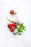 An arrangement of tomatoes, basil and himalayan salt Royalty Free Stock Photography