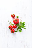 An arrangement of tomatoes and basil Royalty Free Stock Photo