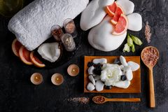 The gravel, candles, towel, buds of flowers, coconut and grapefruit. View from above. Arrangement of a variety of gravel, aroma of candles, soft bath towel Stock Photography