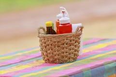 An arrangement of various gourmet condiments in a gift basket. Stock Photos