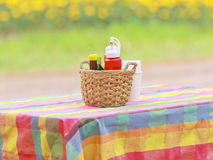 An arrangement of various gourmet condiments in a gift basket Stock Photo
