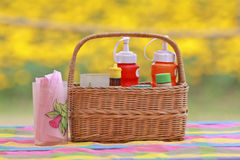 An arrangement of various gourmet condiments in a gift basket Royalty Free Stock Images