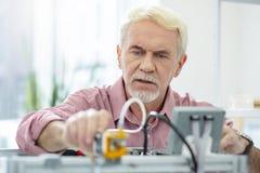 Arrangements changeants agréables d'homme supérieur de l'imprimante 3D Image libre de droits