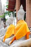 Arrangera i rak linje sittande Buddha Arkivbild