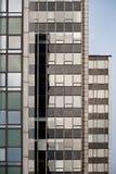 Arrangera i rak linje skyskrapor Fotografering för Bildbyråer