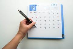 Arrangez rencontrer en décembre le calendrier Images libres de droits
