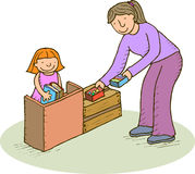 Arranging. Mother or teacher with a girl arranging a place Royalty Free Stock Photo