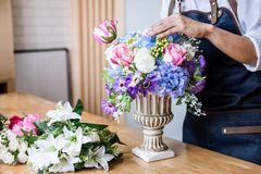 Arranging artificial flowers vest decoration at home, Young woman florist work making organizing diy artificial flower, craft and. Hand made concept stock images