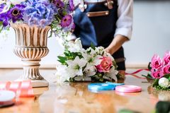 Arranging artificial flowers vest decoration at home, Young woman florist work making organizing diy artificial flower, craft and. Hand made concept stock photography