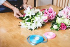 Arranging artificial flowers vest decoration at home, Young woman florist work making organizing diy artificial flower, craft and. Hand made concept stock photos