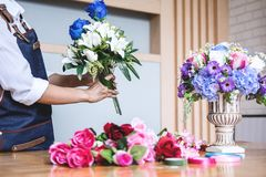 Arranging artificial flowers vest decoration at home, Young woman florist work making organizing diy artificial flower, craft and. Hand made concept stock photo