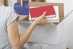 Arranging books Royalty Free Stock Photography