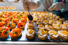 Arranging catering food specialities Stock Photos