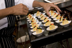 Arranging food. A chef arranging the hors d'oeuvres Royalty Free Stock Photography