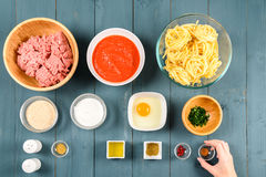 Arranging Food Ingredients On Table Royalty Free Stock Photo