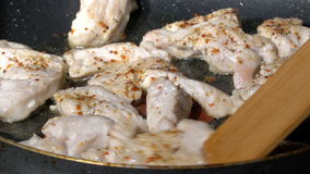 Arranging meat on a frying pan stock video footage
