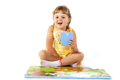 Arranging puzzles young girl royalty free stock image