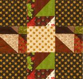 Arranging quilt design on batting. Placing different patches for patchwork quilting on a piece of batting Stock Photography