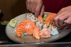 Arranging sushi. Stock Photo