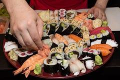 Arranging sushi plate. Stock Photography