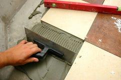 Arranging tiles Stock Photos