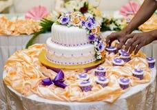 Arranging the wedding cake Stock Images