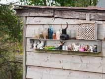 Arrangment of ornaments outside on shed on allotment. Essex; england; uk Stock Photos