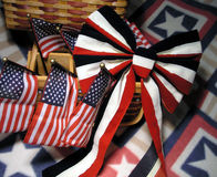 Arrangment in Red, White, and Blue. Flags, baskets, and bow on top of a star blanket royalty free stock photos