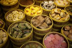 Arrangment of various dim sum in bamboo steamer. With chinese snack pastry in chinese restaurant Stock Images