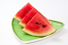 Arrangment of watermelon slices on the green plate.  Stock Image