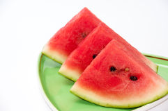 Arrangment of watermelon slices on the green plate Royalty Free Stock Photos