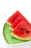 Arrangment of watermelon slices on the green plate.  Royalty Free Stock Photography