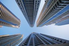 Arranha-céus do escritório no fundo do céu azul Fotografia de Stock Royalty Free