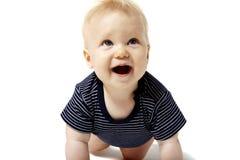 Arrastre feliz del bebé Fotos de archivo