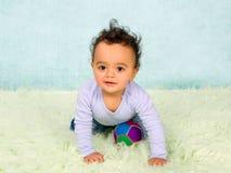 Arrastre juguetón del bebé Fotografía de archivo libre de regalías