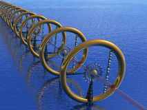 Array. Strange Array with golden torus in a blue ocean - viewed from above Stock Images