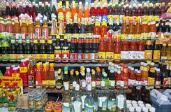 Array of asian sauces, cooking oil and other ingredients in bottles for sale in Thailand stock image