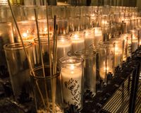 A votive candle or prayer candle is a small candle, typically white or beeswax yellow, intended to be burnt as a votive offering royalty free stock photos