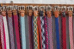 Row of colorful braided belts for sale as souvenirs Stock Image