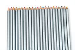 Array of crayons. Lined up, isolated against white background stock photo