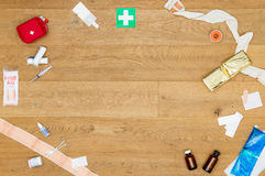 Array of first aid kit objects on wooden surface with copyspace Stock Images