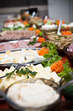 Array of food on buffet table. Selection of different food laid out on buffet table Stock Photo