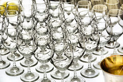 Array of glasses on white table - metallic colors Royalty Free Stock Image