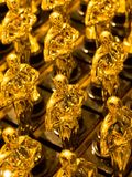Array of golden statues. Close up of an array of golden statues Royalty Free Stock Image