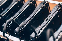 Array of GPUs for mining rig machine to mine for digital cryptocurrency such as bitcoin, ethereum and other altcoins. Close up of array of GPUs for mining rig stock image