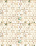 An array of hexagons. A grunge background created by an array of small tightly packed hexagons with a few illegible words and letters stock photo
